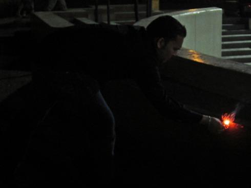 Abhi lighting a firecracker in Chosica Plaza on NYE